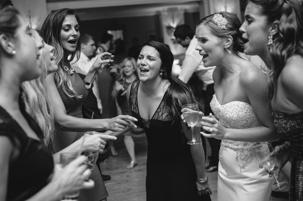 bride singing during wedding reception
