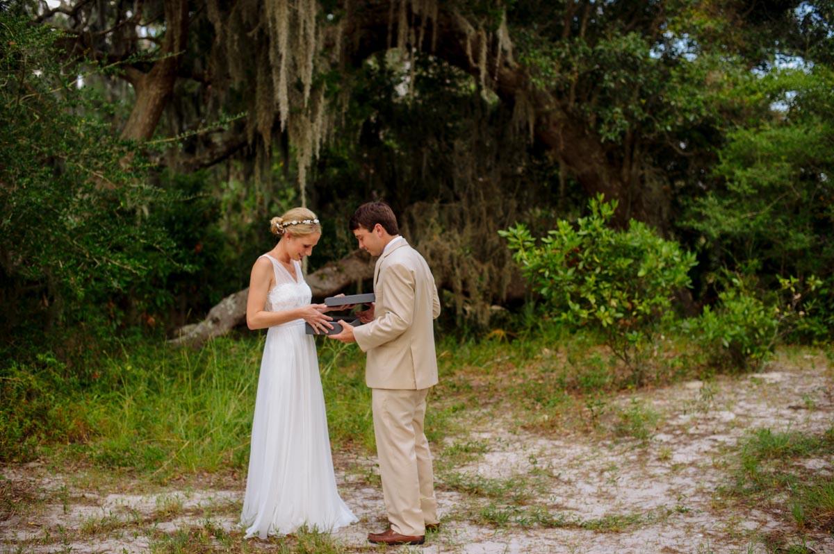 groom giving bride thoughtful album