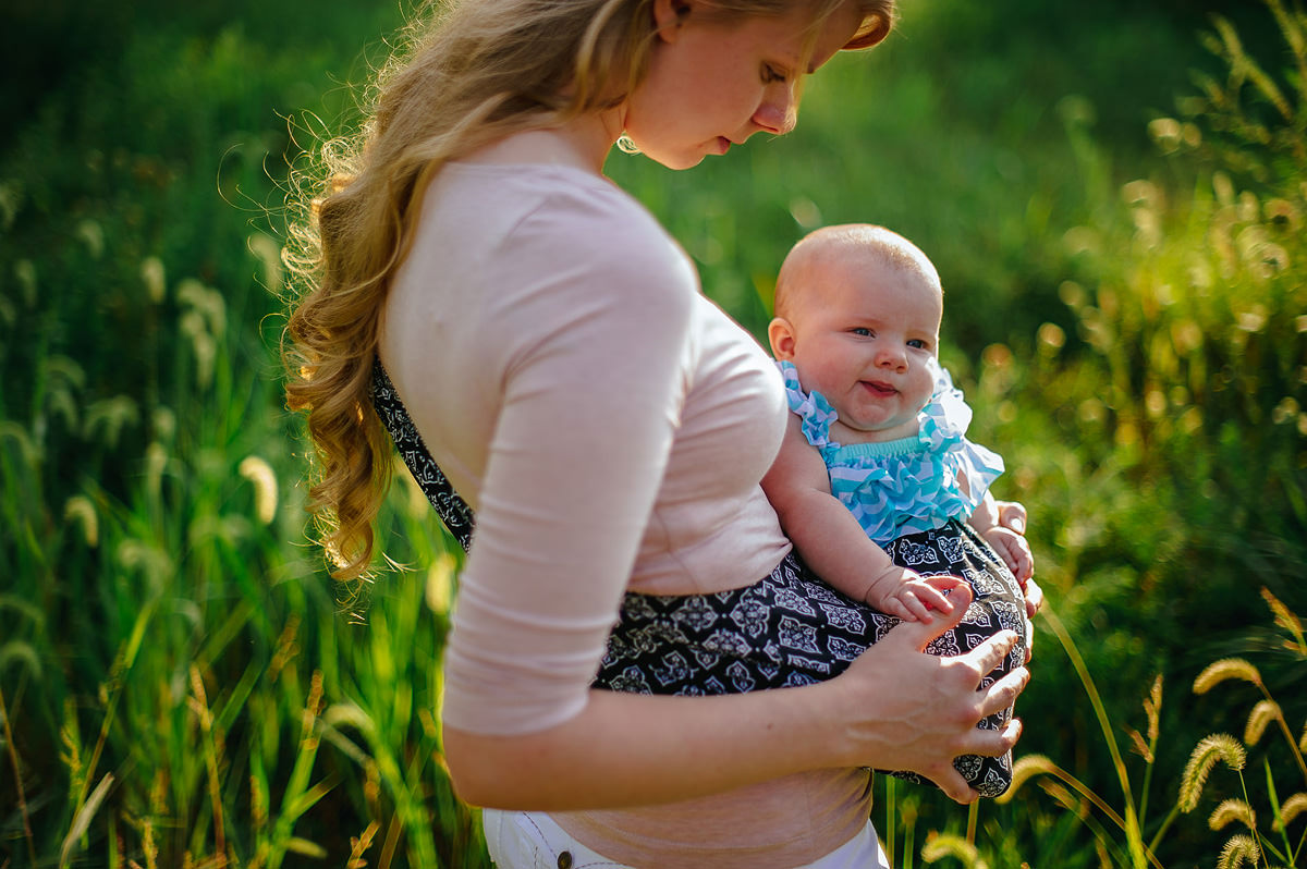 mom carrying baby in sling by pittsburgh photographers the oberports