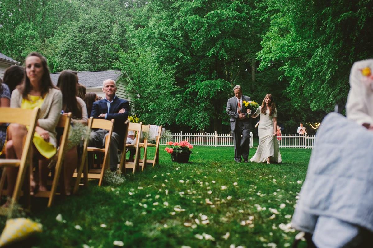 bride and dad wedding processional outdoor