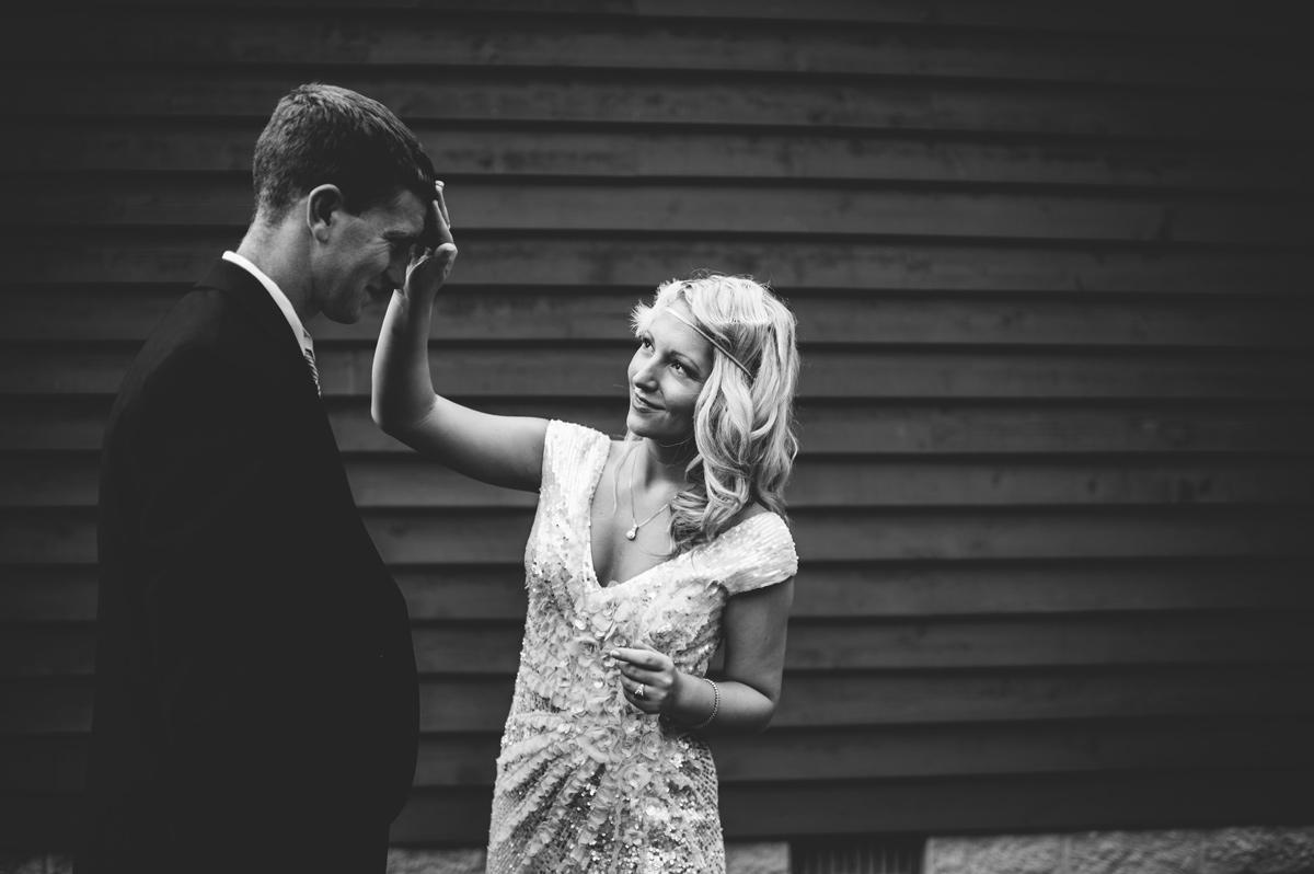 bride fixing grooms hair
