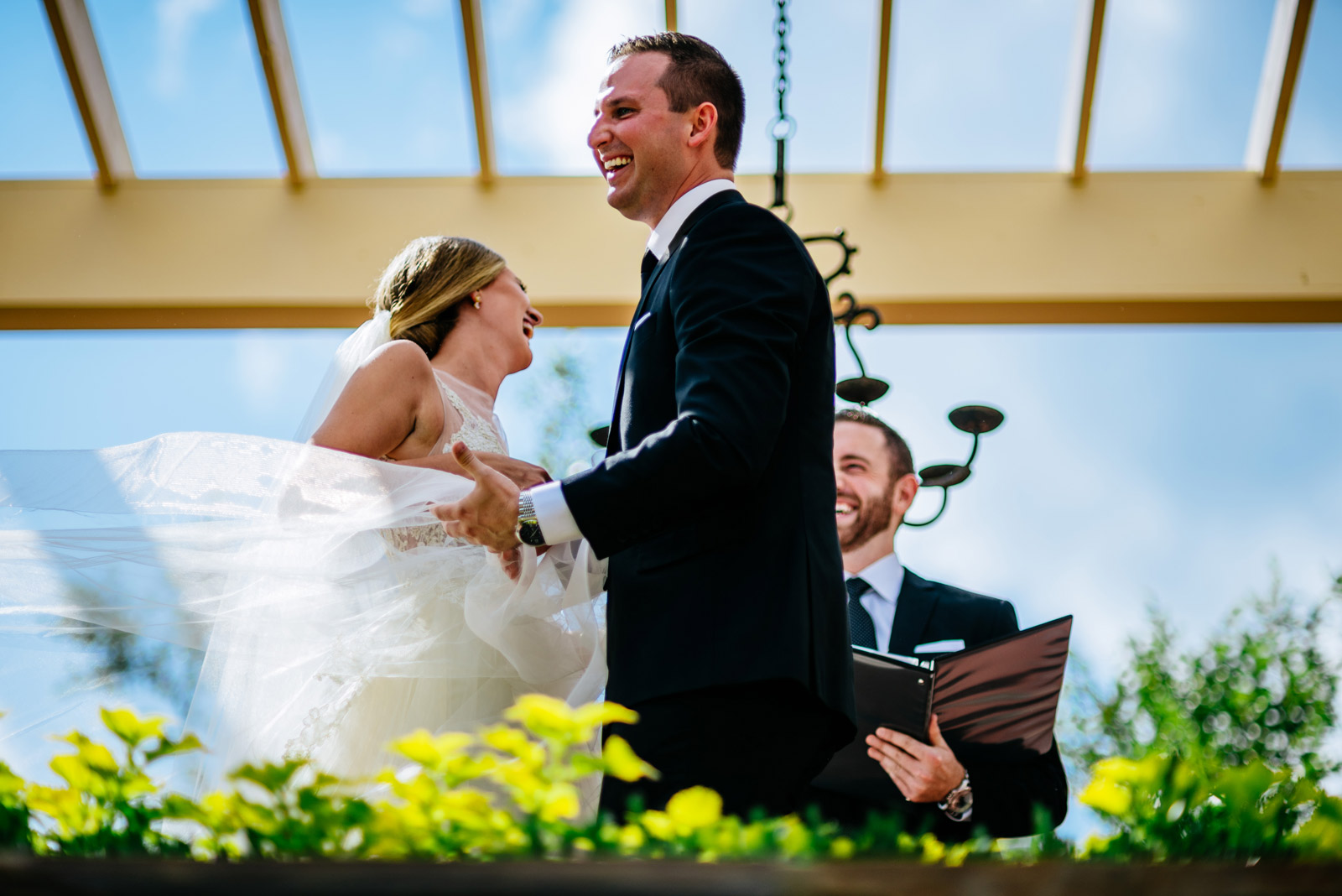 bride groom laughing during ceremony
