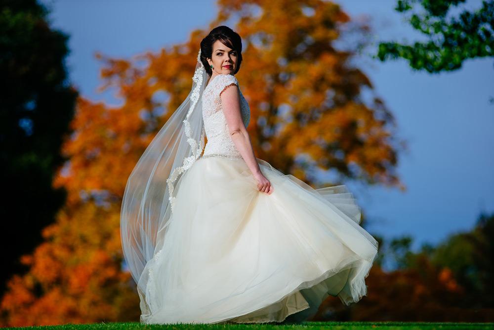 bride twirling in elegance by roya couture gown at oglebay resort wv