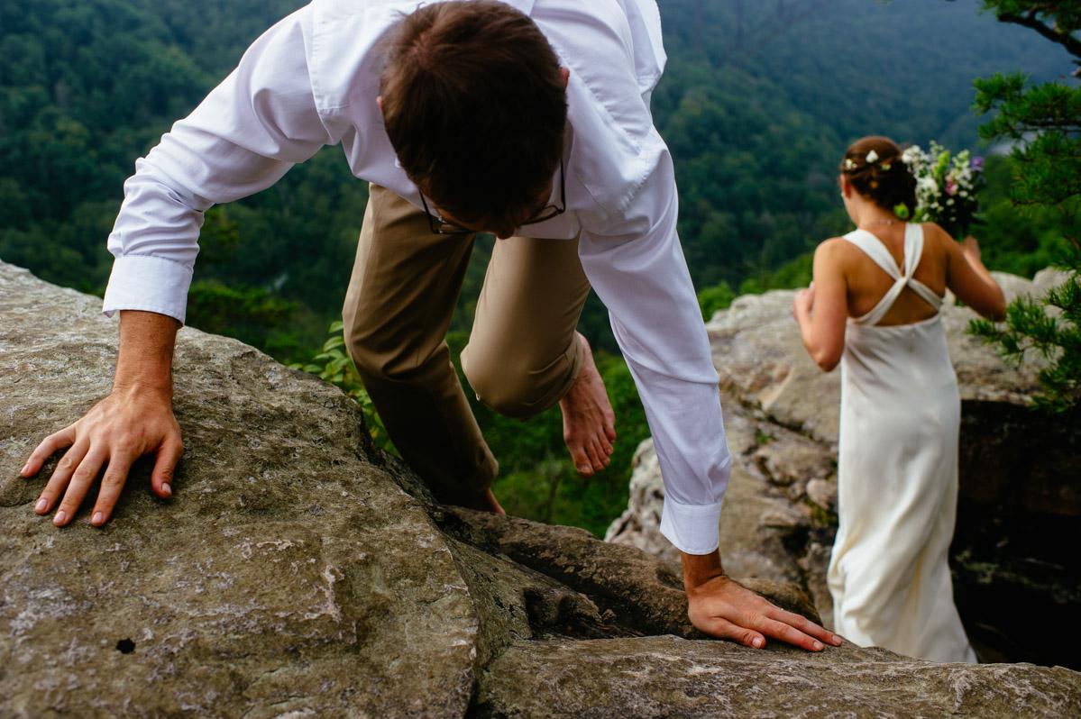 groom climbing rocks cliff on long point trail