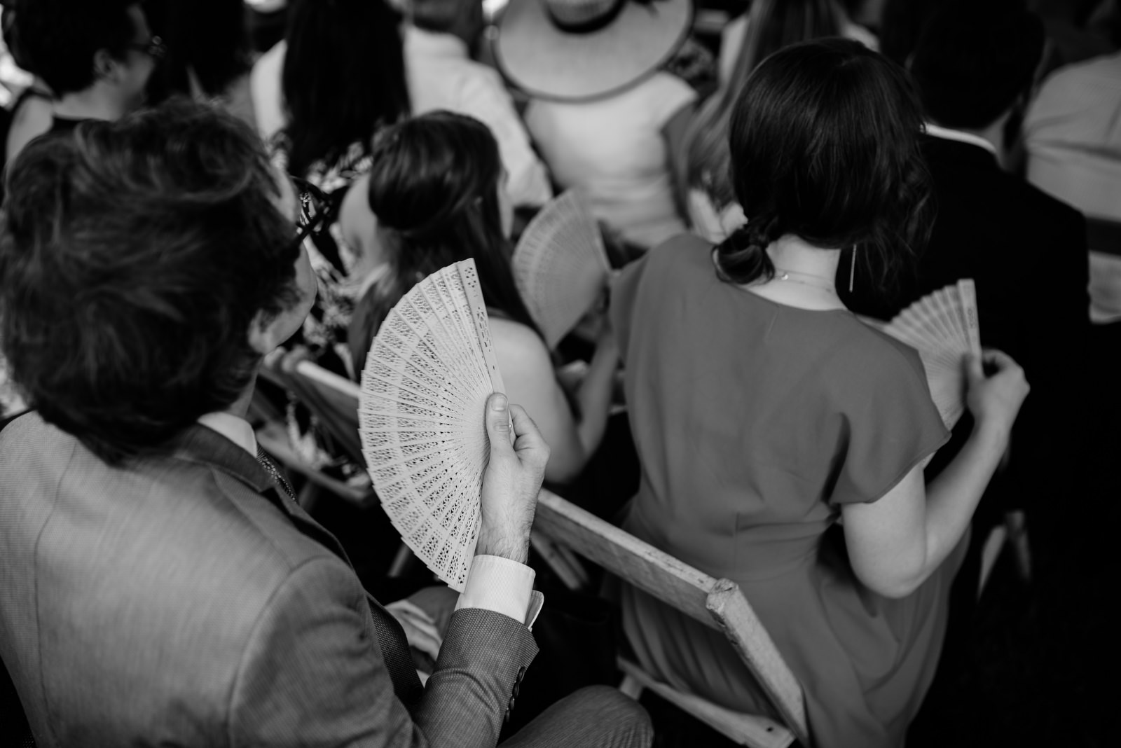 guest using hand fan holly hill inn wedding lexington ky