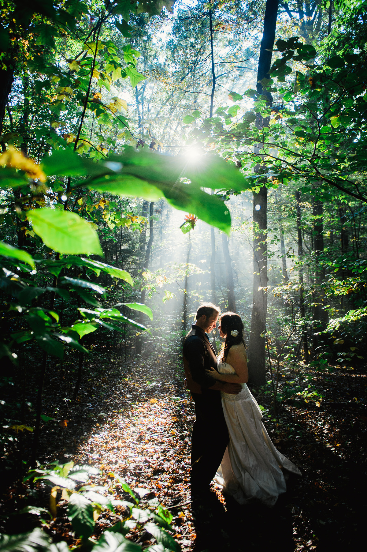 bride and groom portrait with beautiful streaming light