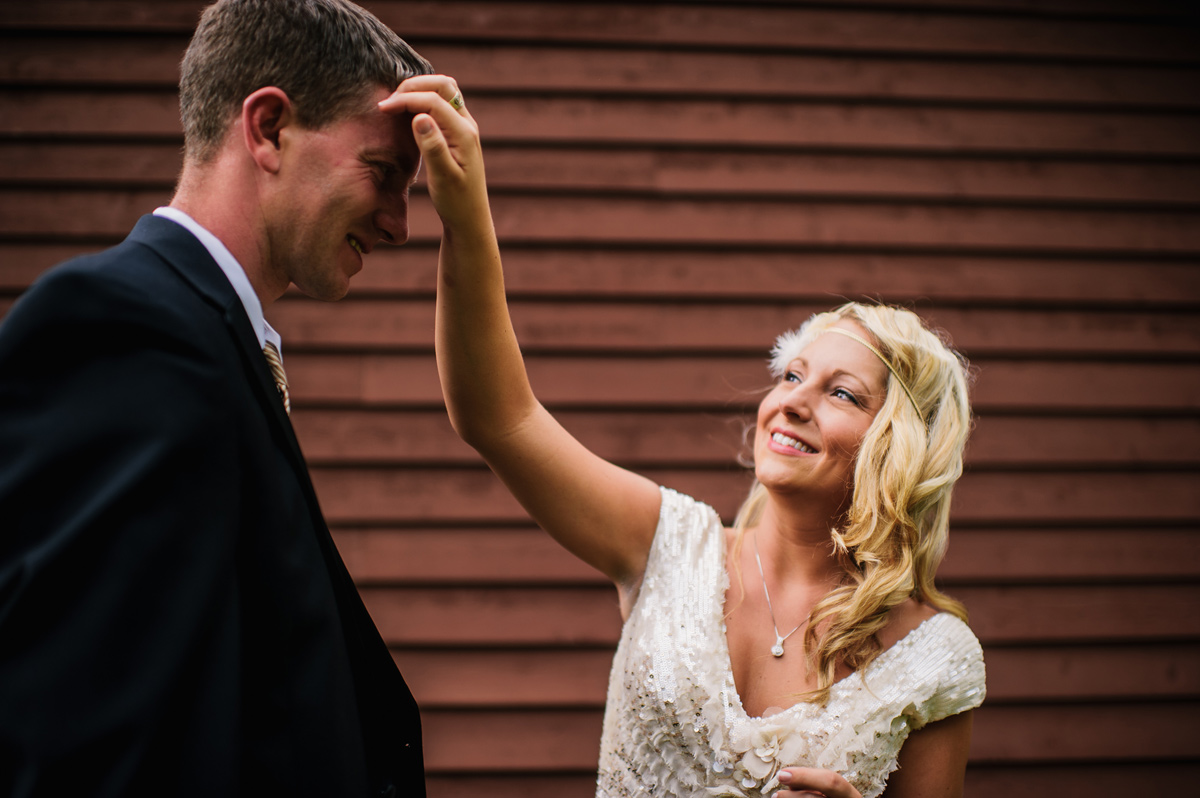 bride fixing grooms hair