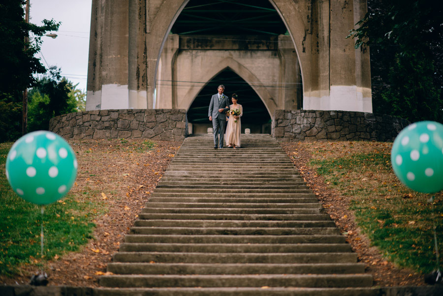 bride walking down steps cathedral park portland