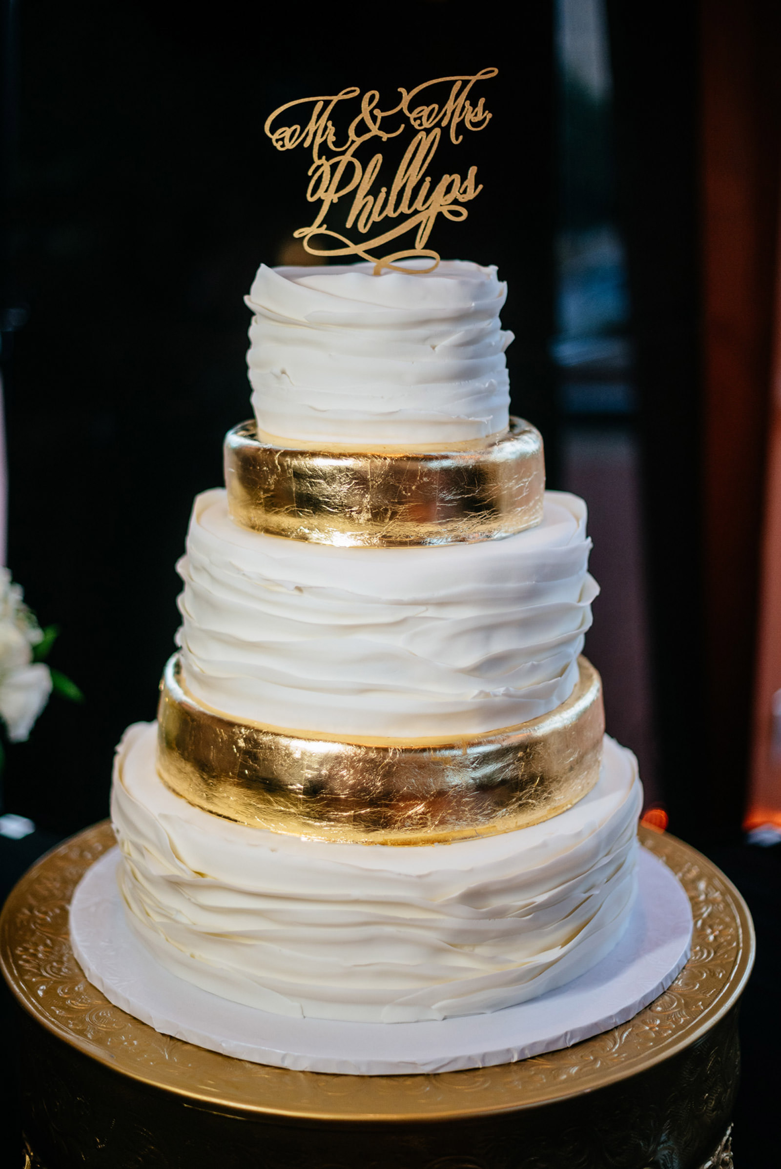 clay center wedding cake gold foil