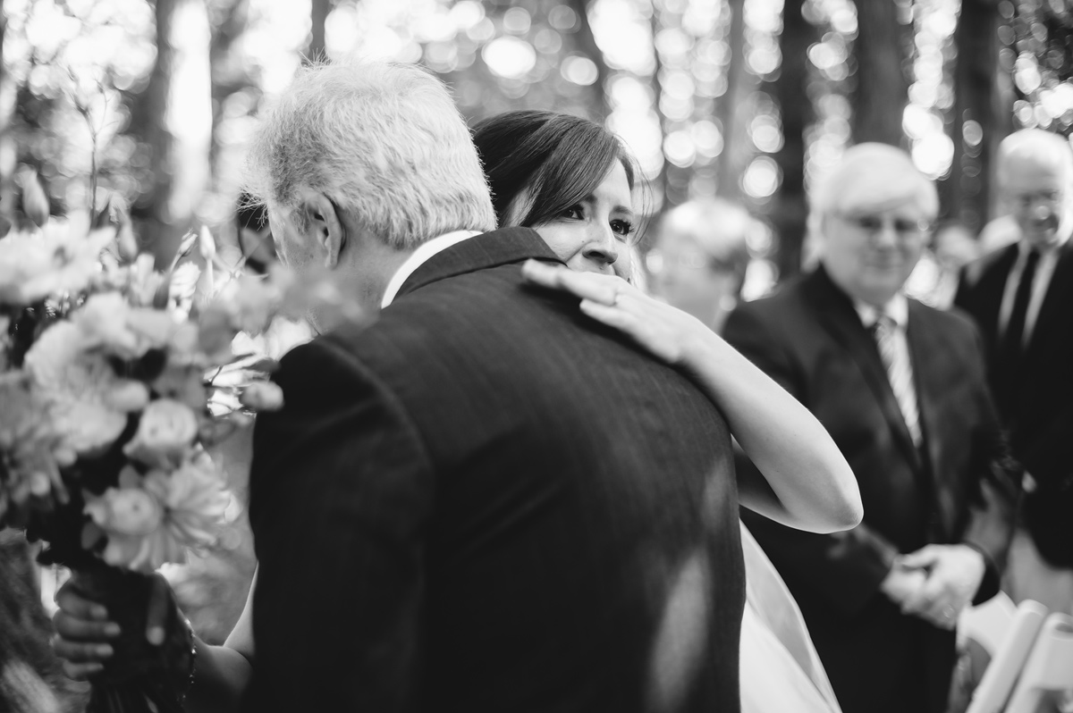 emotional bride walking down aisle