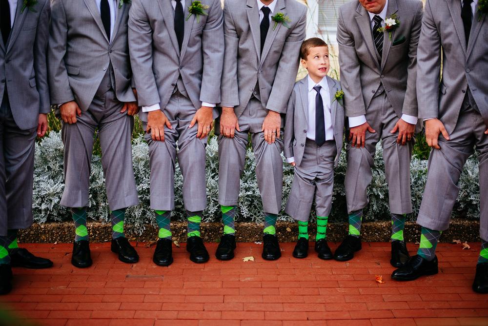 ring bearer showing socks with groomsmen