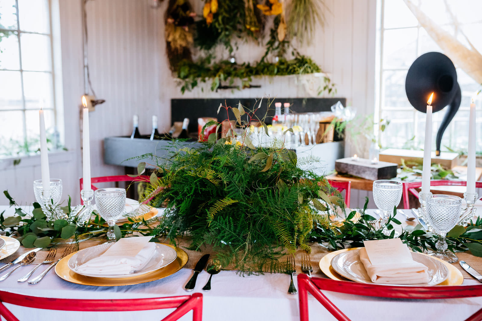 ferns greenery centerpiece on table mushroom house terain elopement