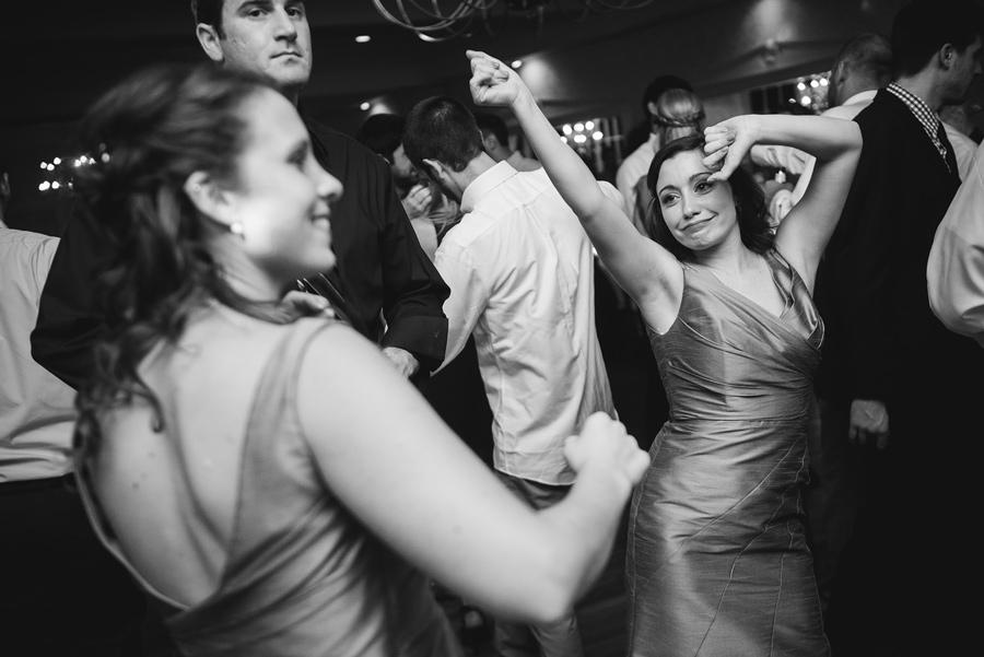 sister of the bride dancing at wedding