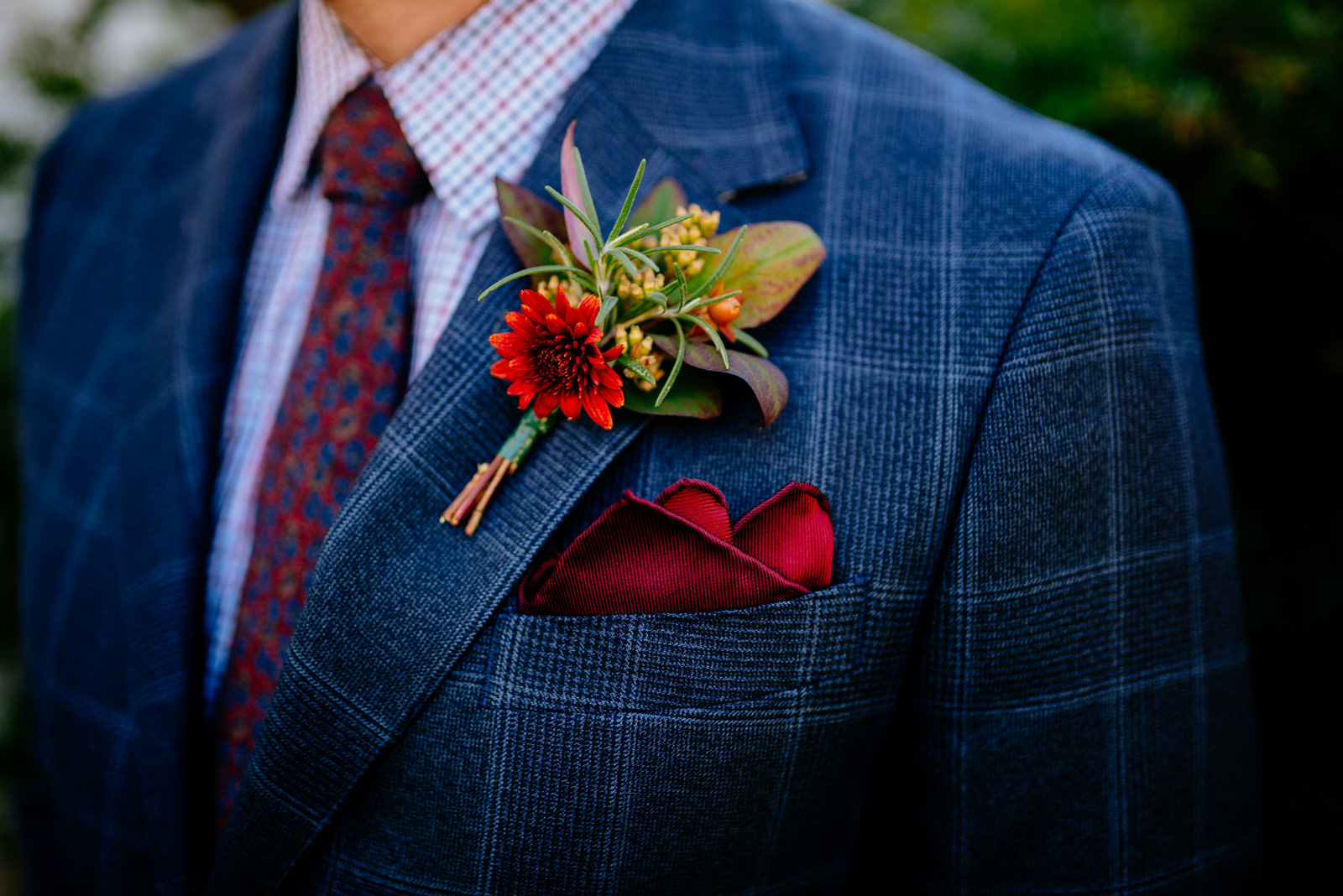 boutonniere on groom plaid jacket red pocket square wedding details