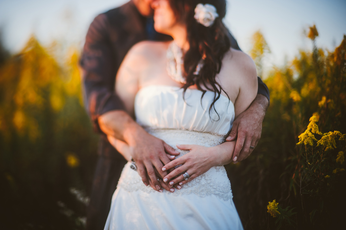 creative bride and groom portrait at sunset