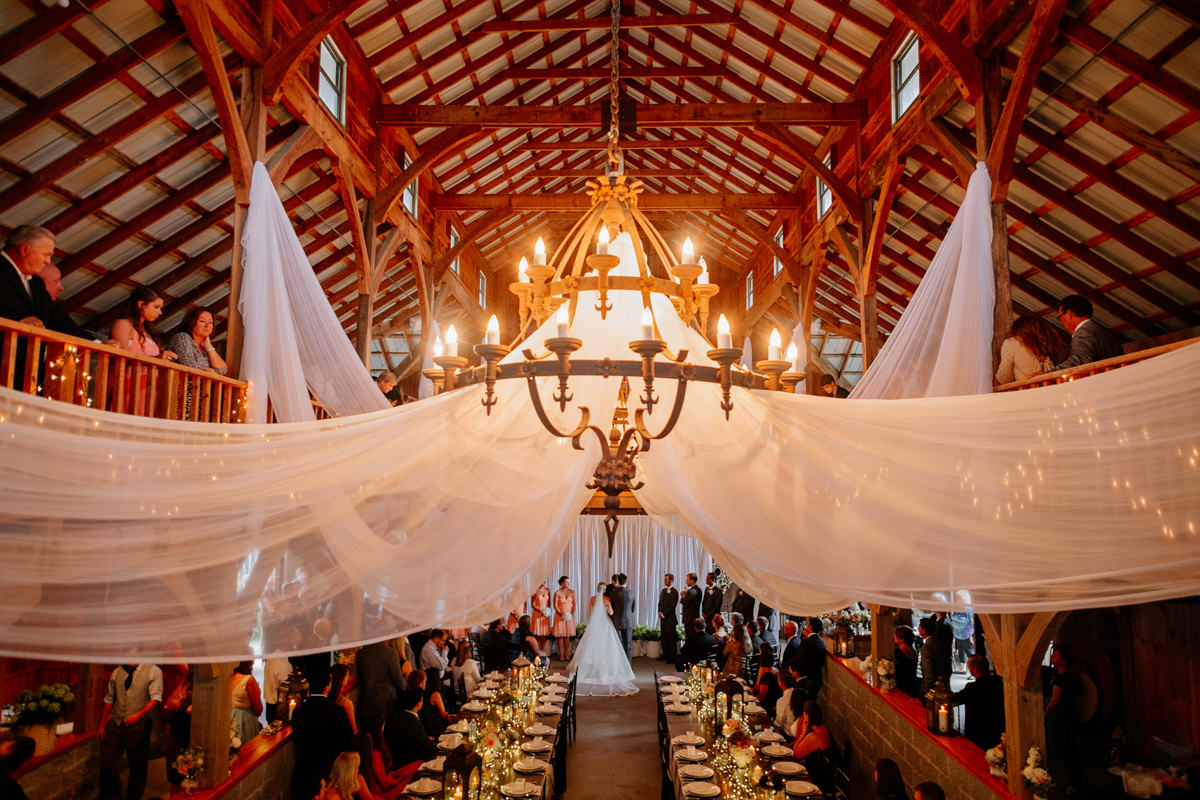 beautiful indoor wedding ceremony in barn by the oberports