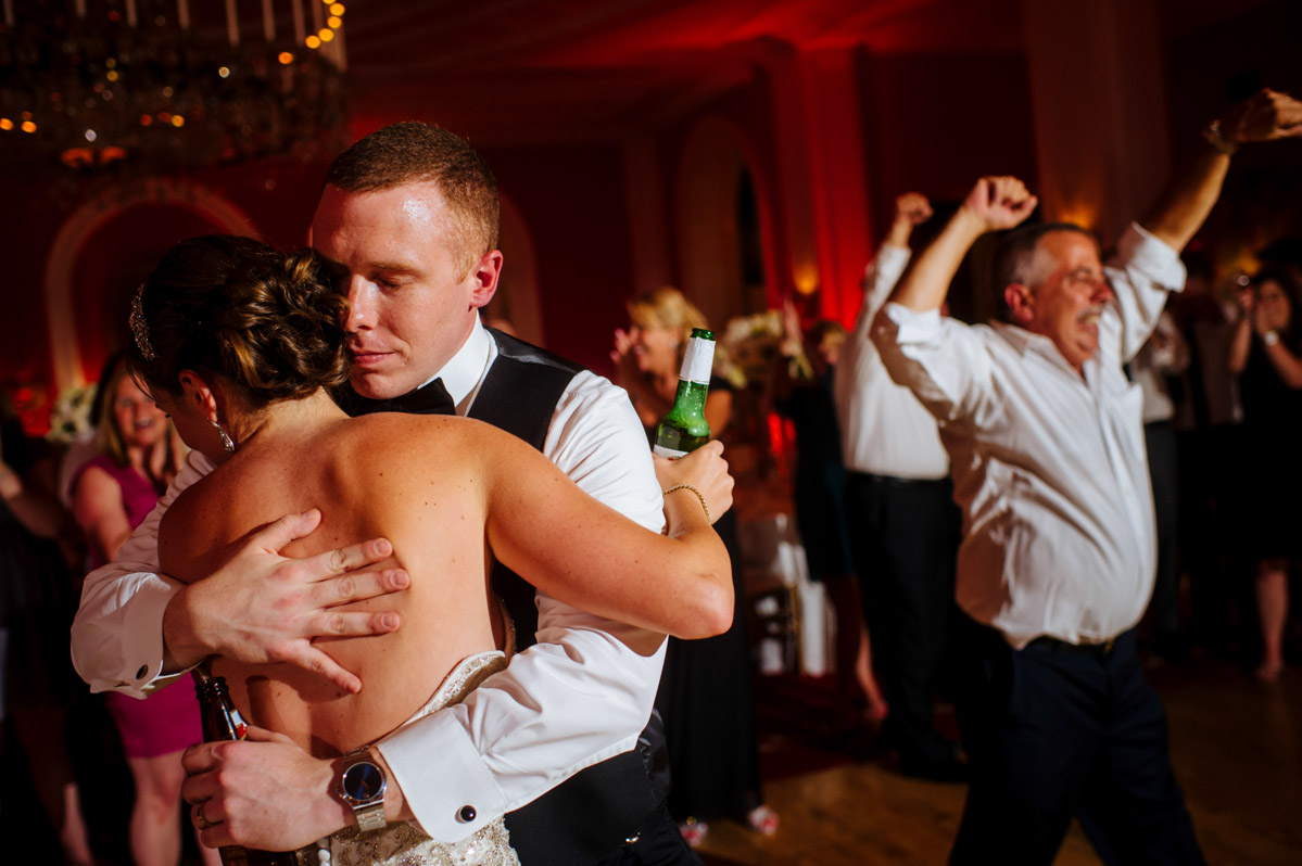 bride groom emotional embrace during wedding reception by wv documentary photographers the oberports