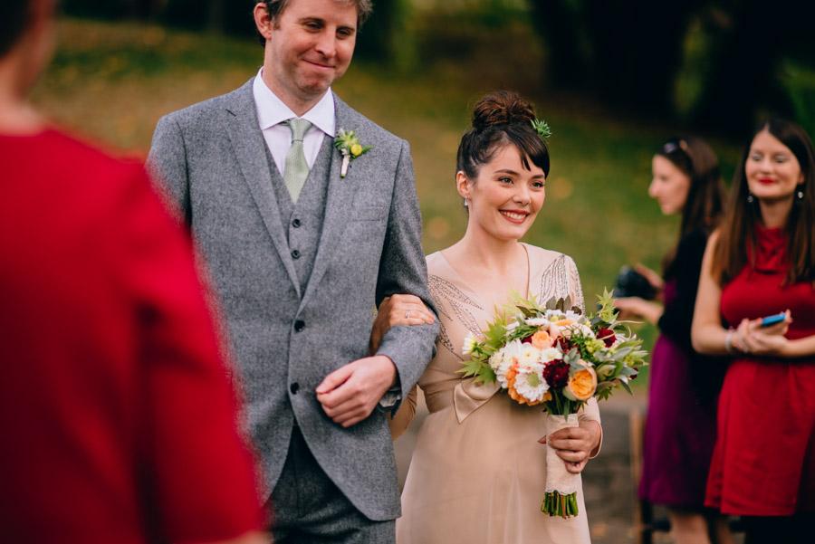 happy bride and groom walking down aisle wedding photojournalism