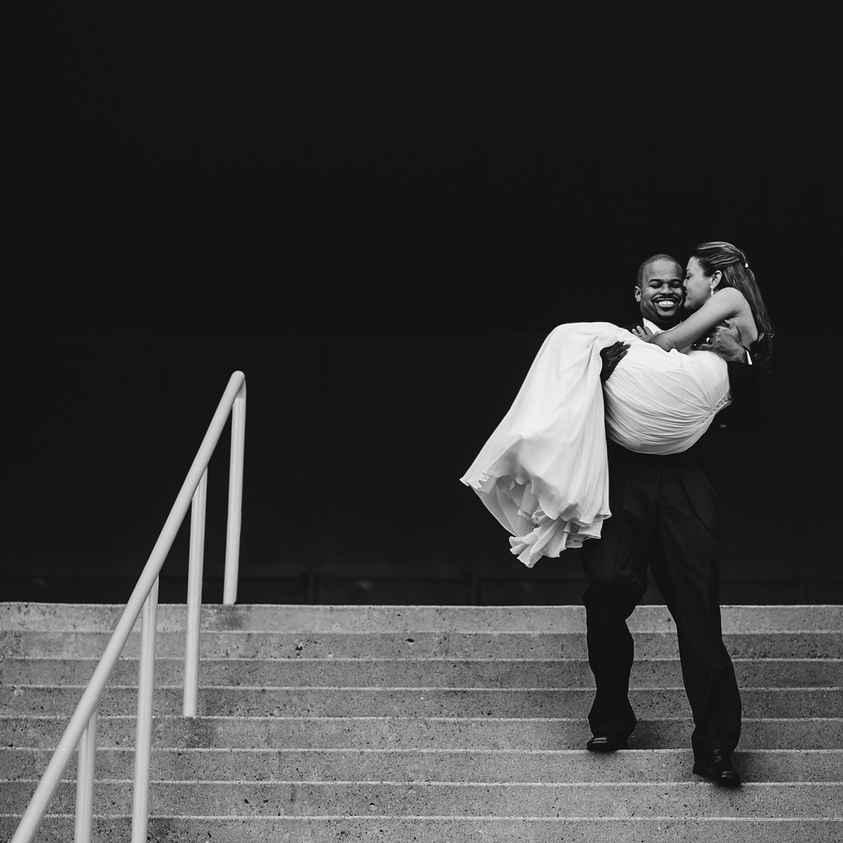 awesome photo of groom carrying bride in charleston west virginia
