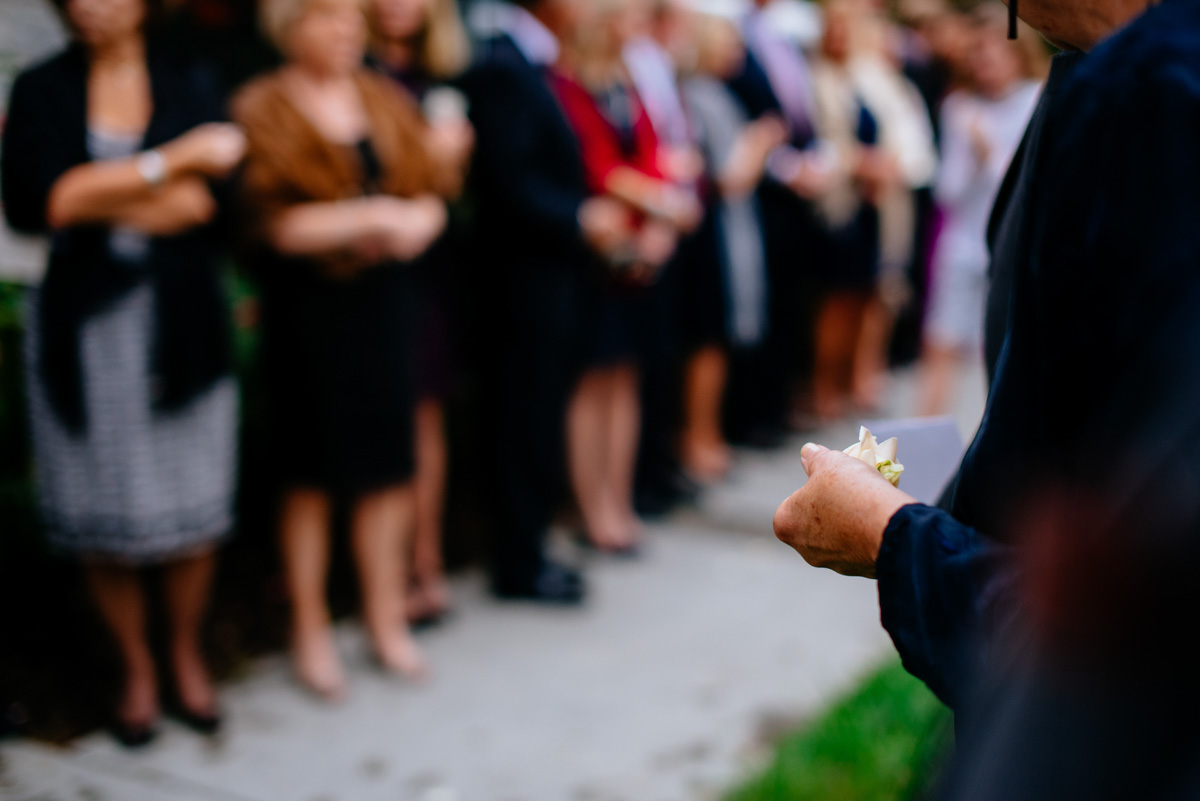 flower petals throwing while exiting church wedding ceremony