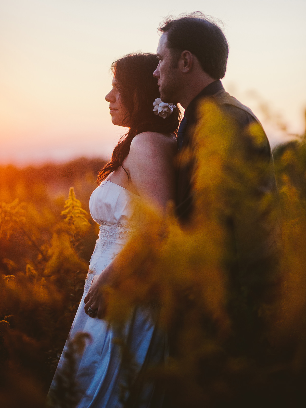 beautiful bride and groom portrait at sunset