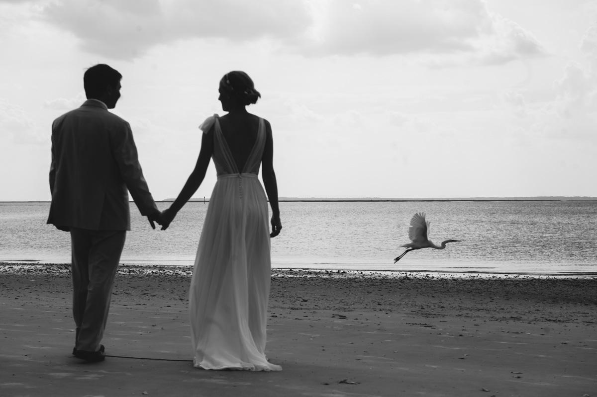 bride and groom wedding day portrait with egret bird