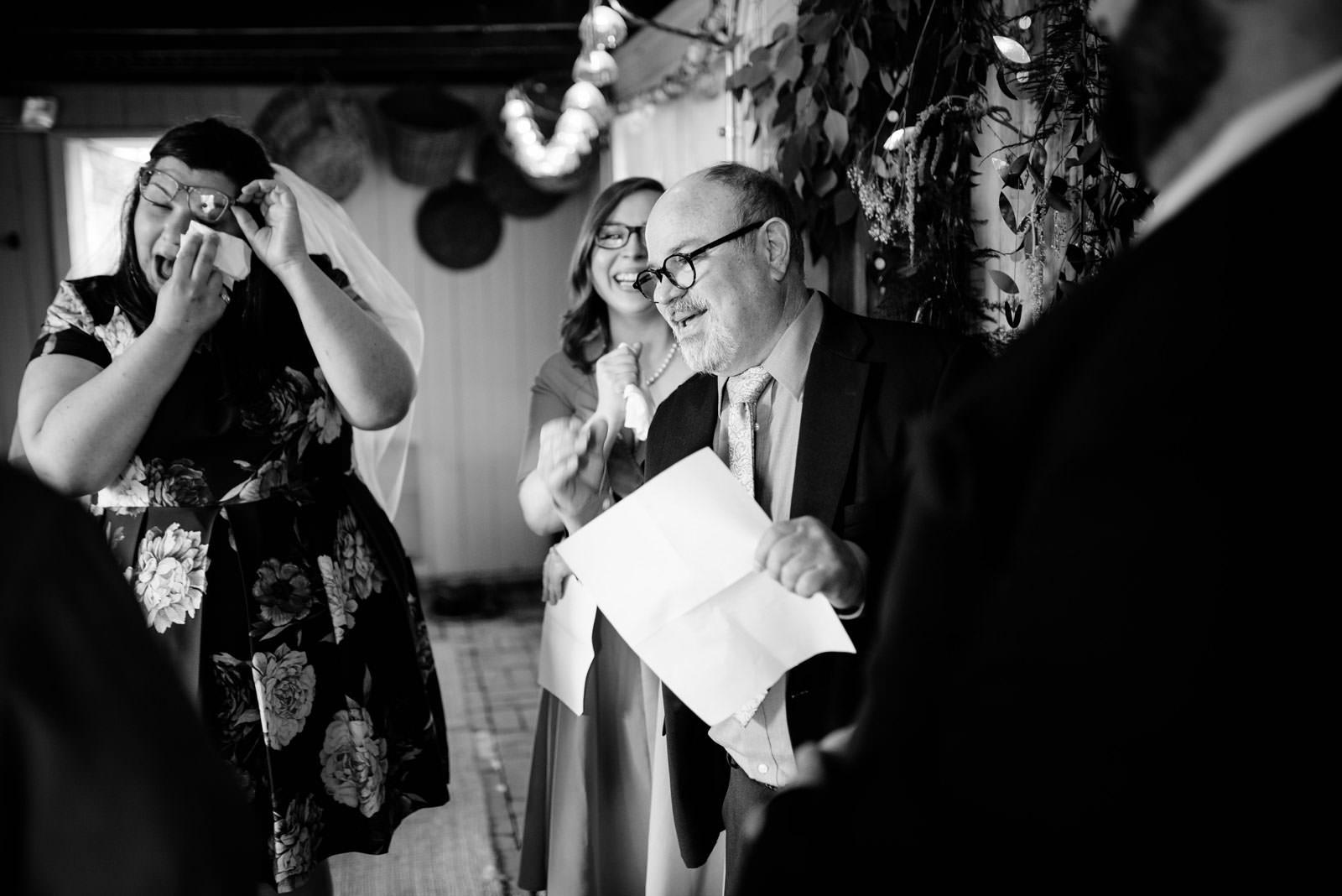 dad speaking bride wiping tear ceremony in mushroom house terrain elopement