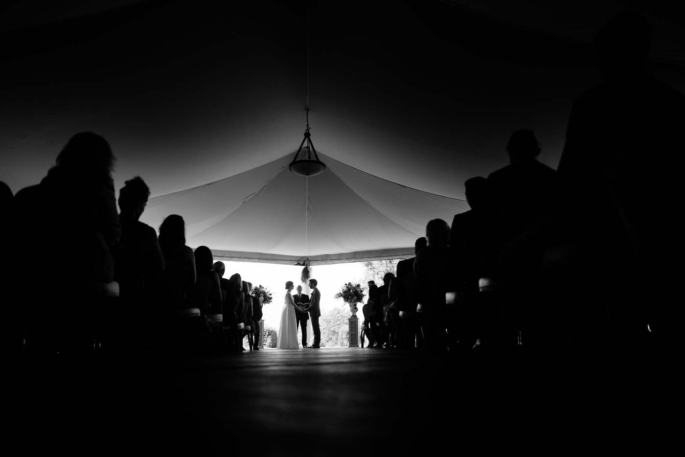 wedding ceremony under a tent