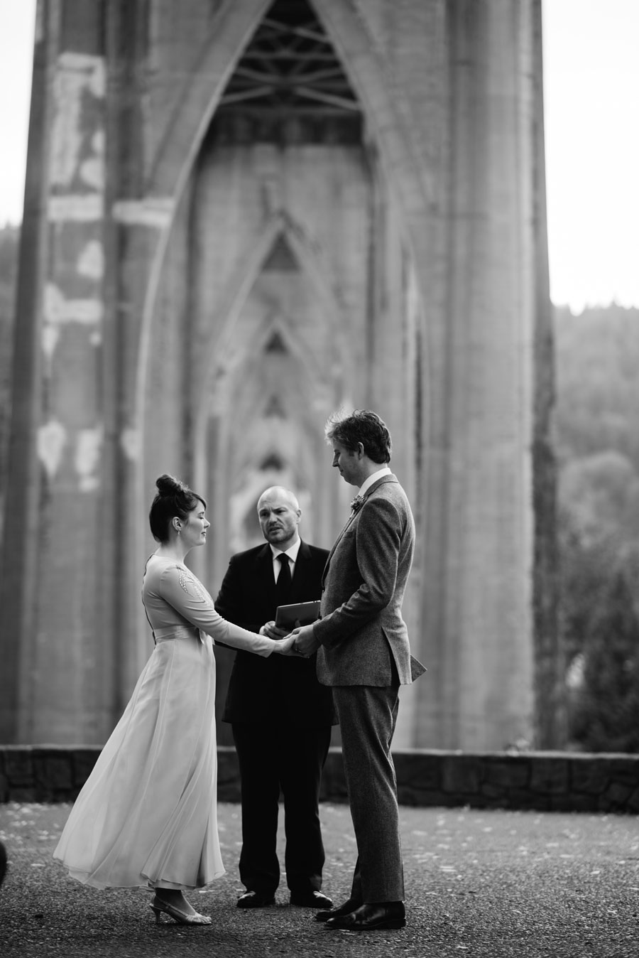 black and white bride groom holding hands during ceremony1