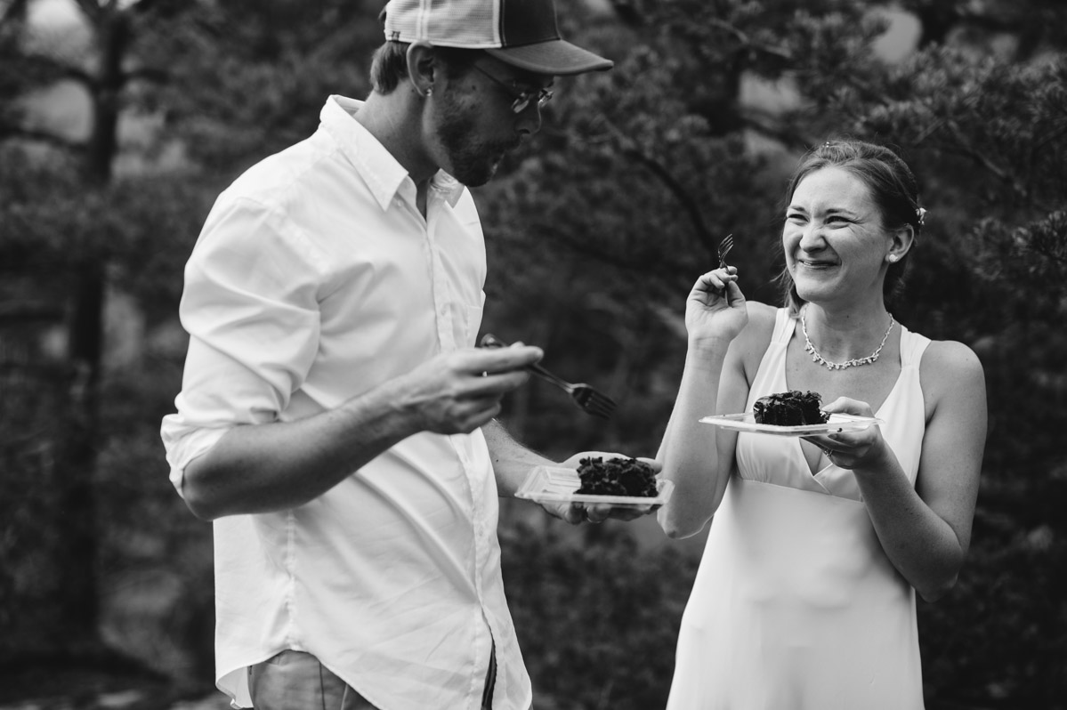 bride and groom eating chocolate cake documentary wedding photographer the oberports