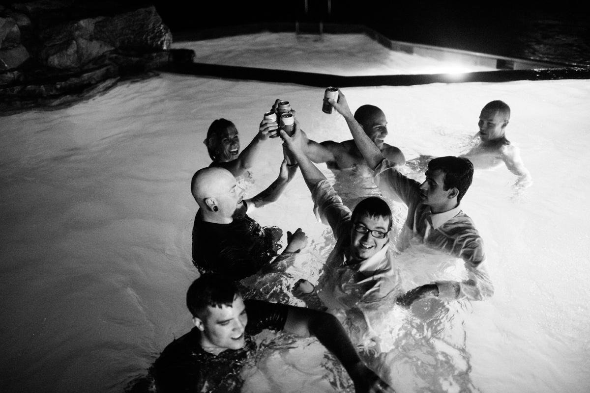 groomsmen jumping in pool