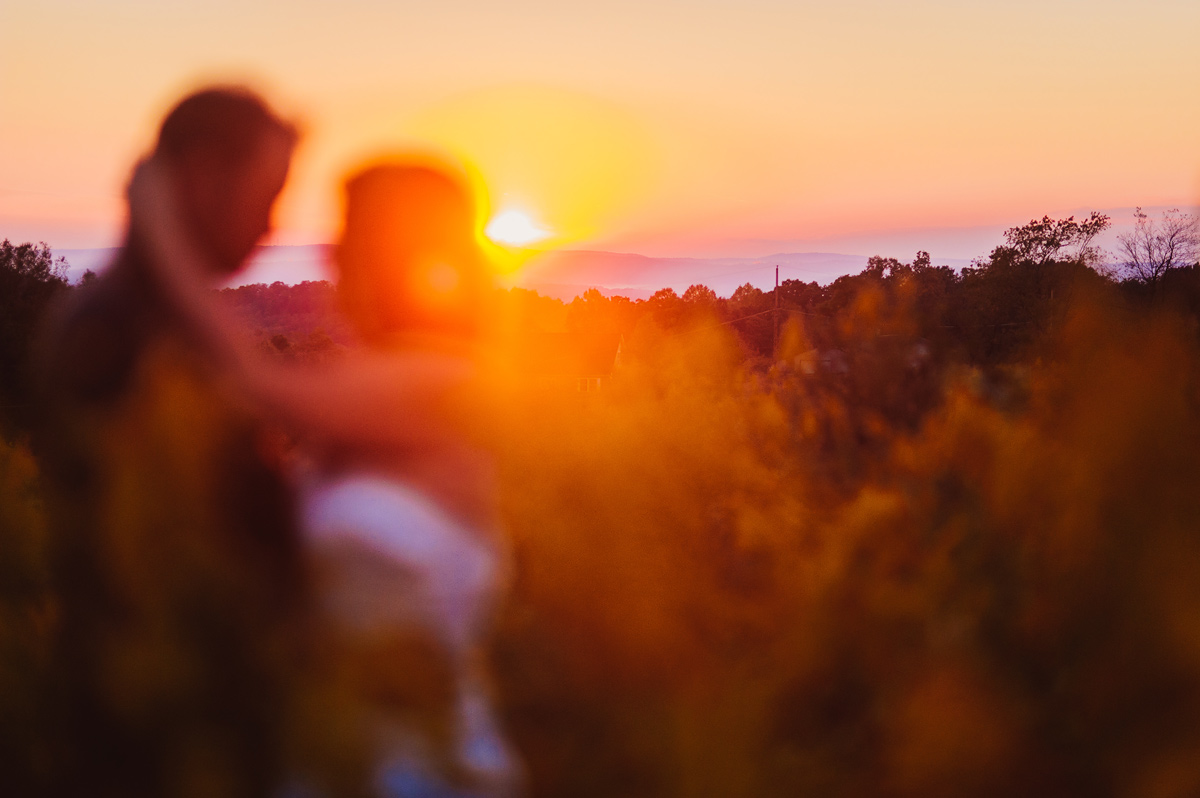 beautiful bride and groom portrait at sunset at fallingwater