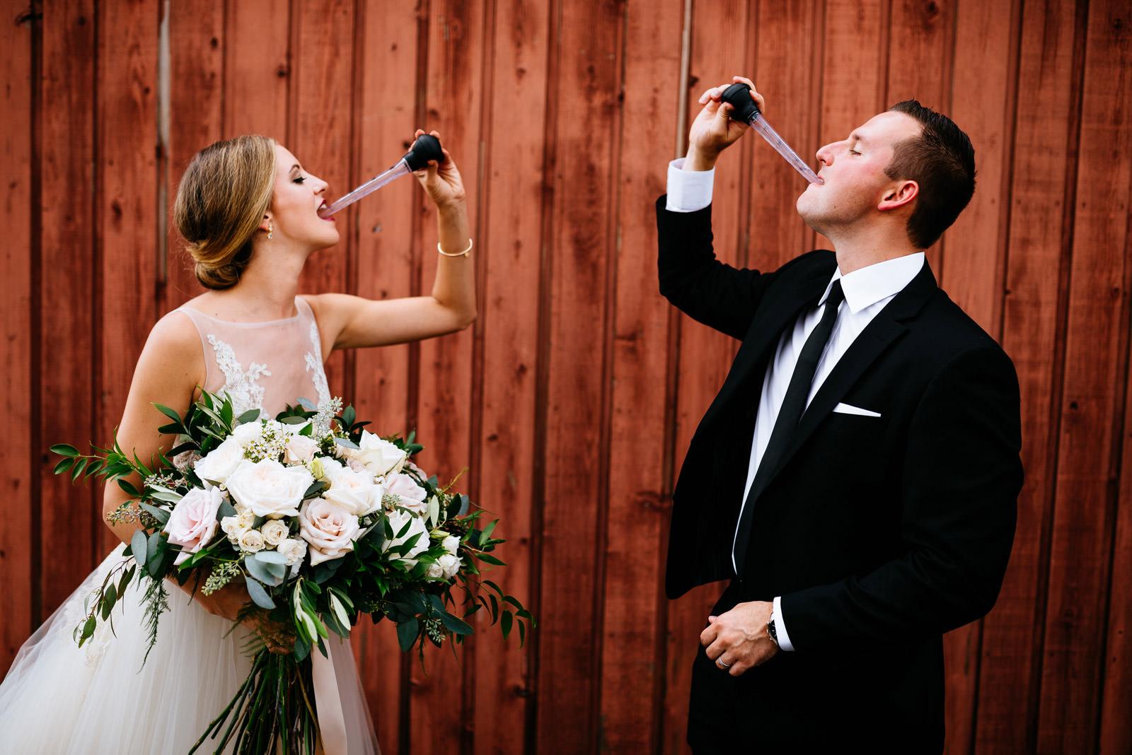 bride groom take gin bucket shots zenner house wedding athens ohio