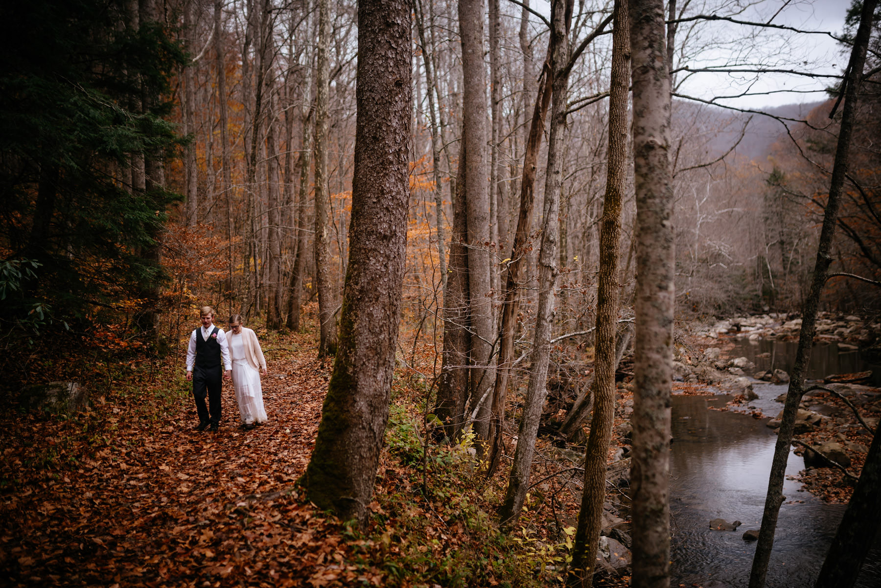 bride groom walking along glade creek wv hiking elopement
