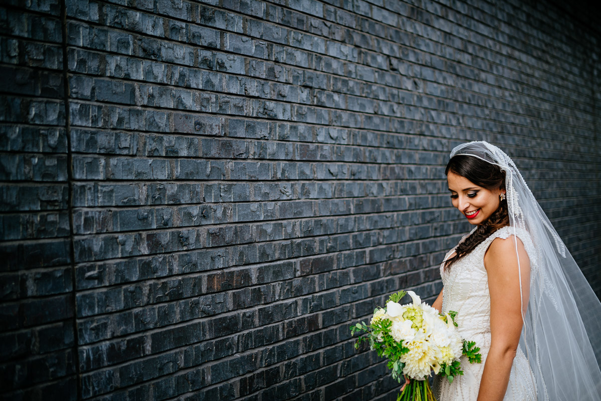 bridal portrait against black wall