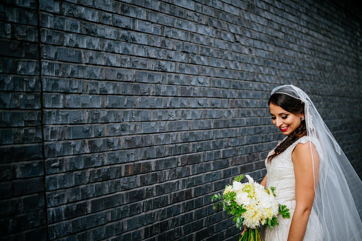 bridal portrait against black wall