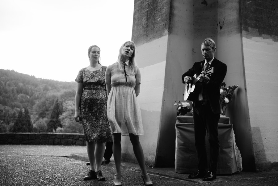 friends singing playing song during cathedral park portland wedding ceremony moments