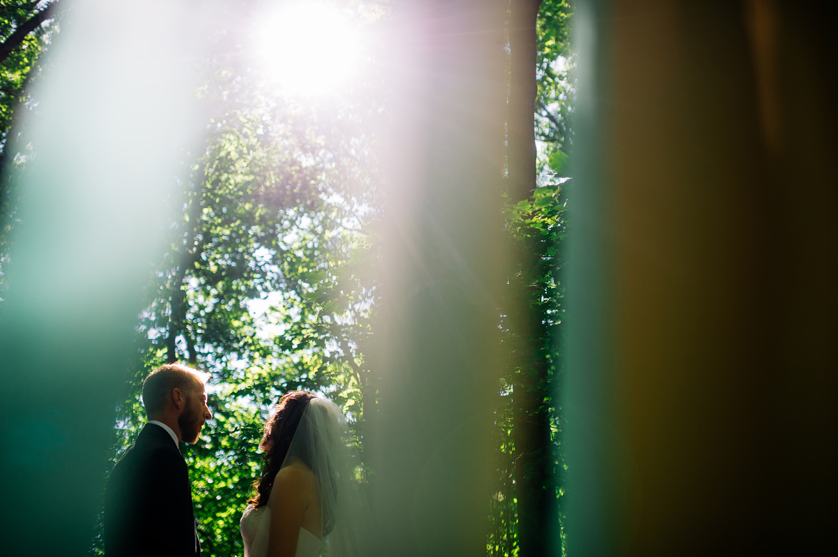 bride and groom with streamers in the woods