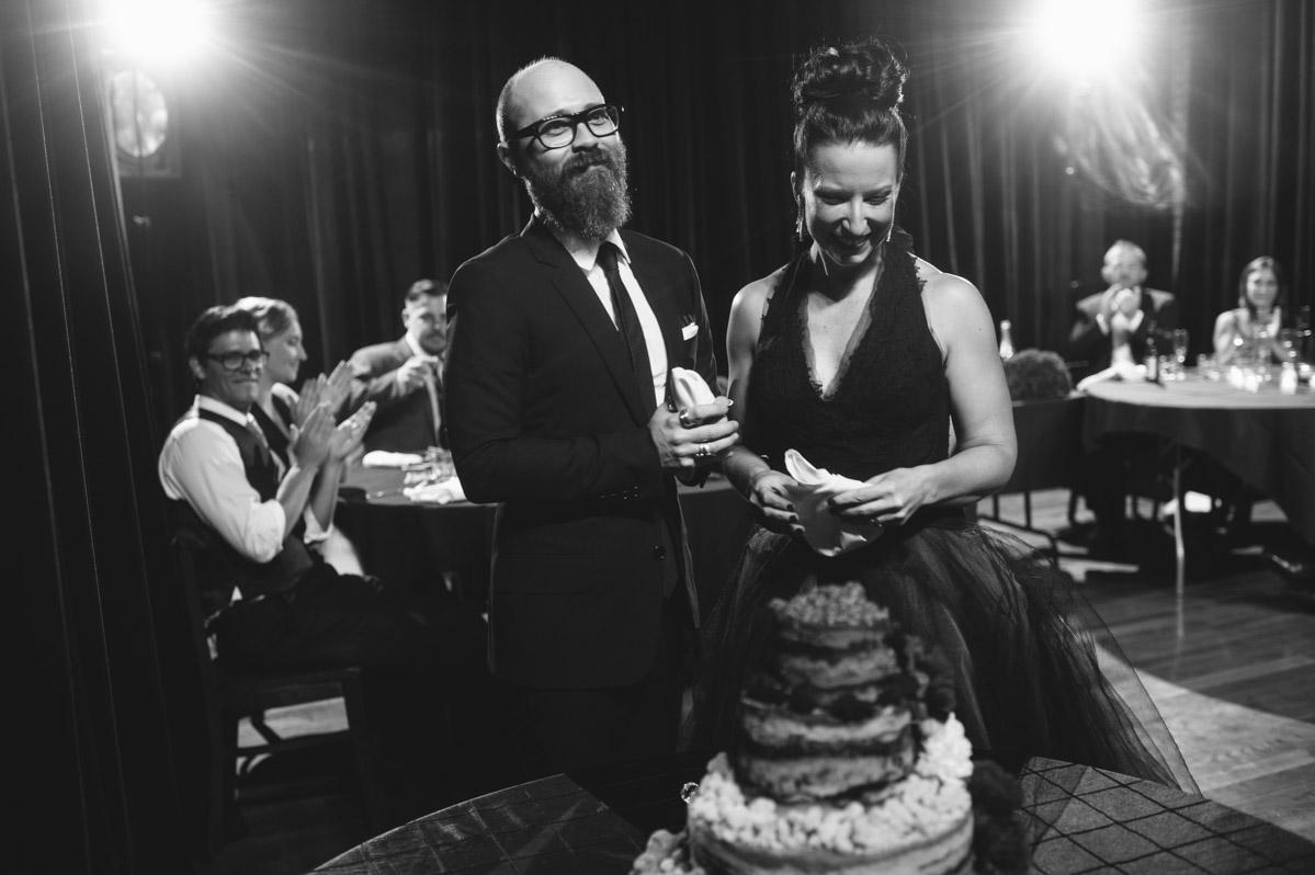 bride groom cutting momofuku milk bar cake at wedding reception by the oberports