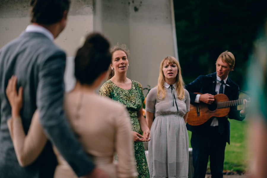 friends singing during cathedral park portland wedding ceremony