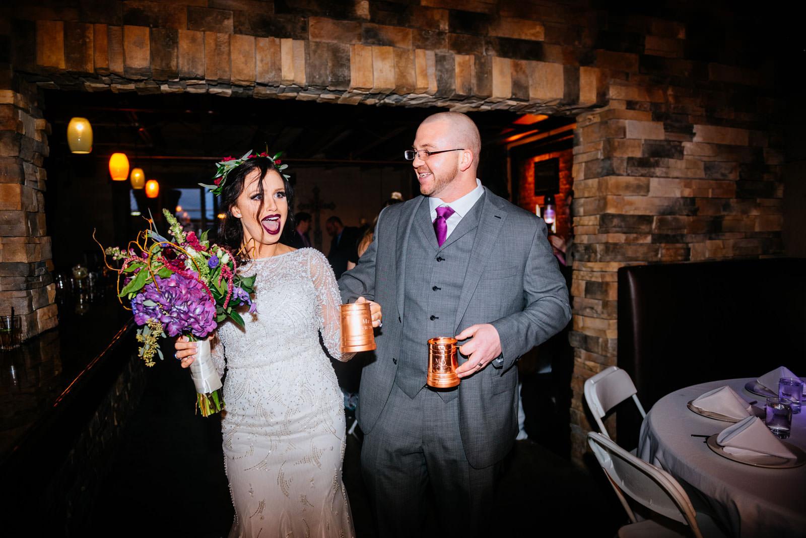bride groom entering reception rocktop bar