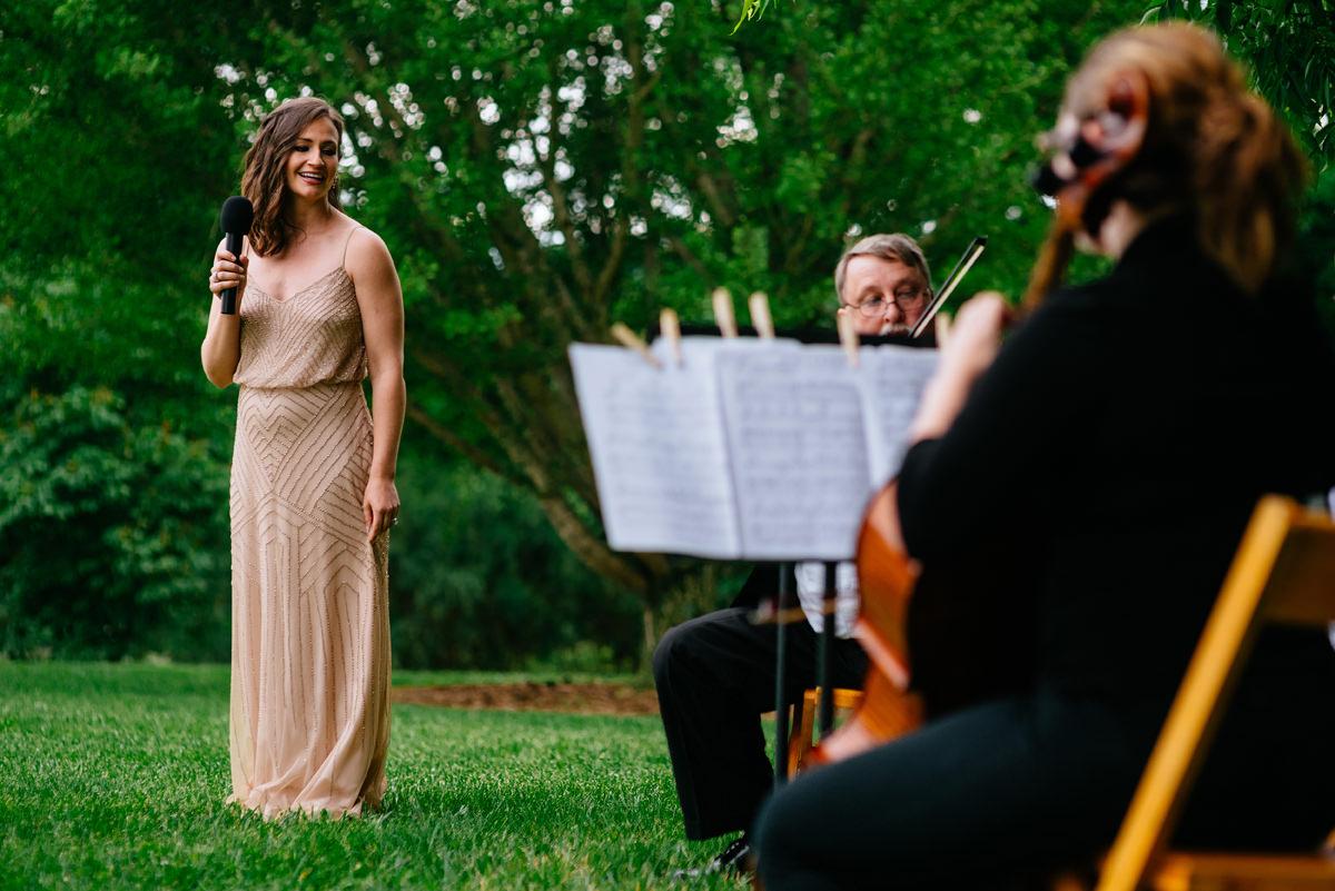 brides sister singing during wedding ceremony