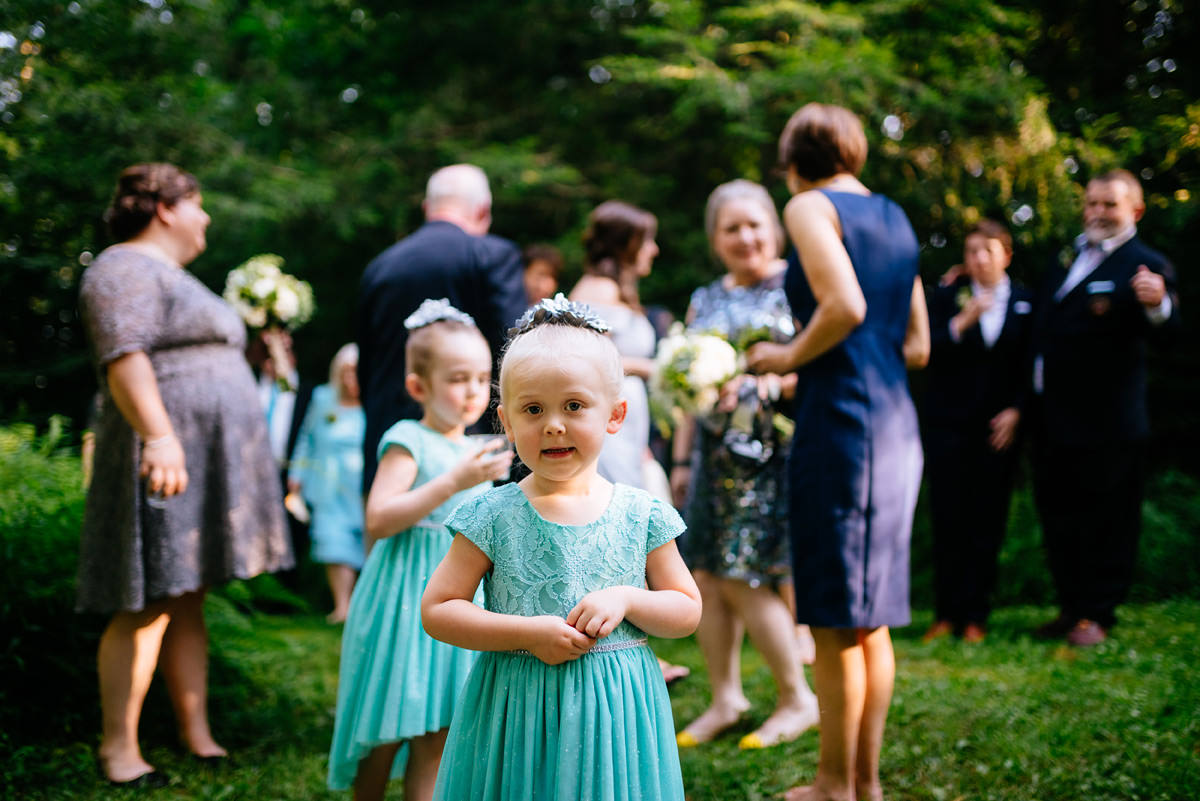 cute flowergirls after wedding ceremony