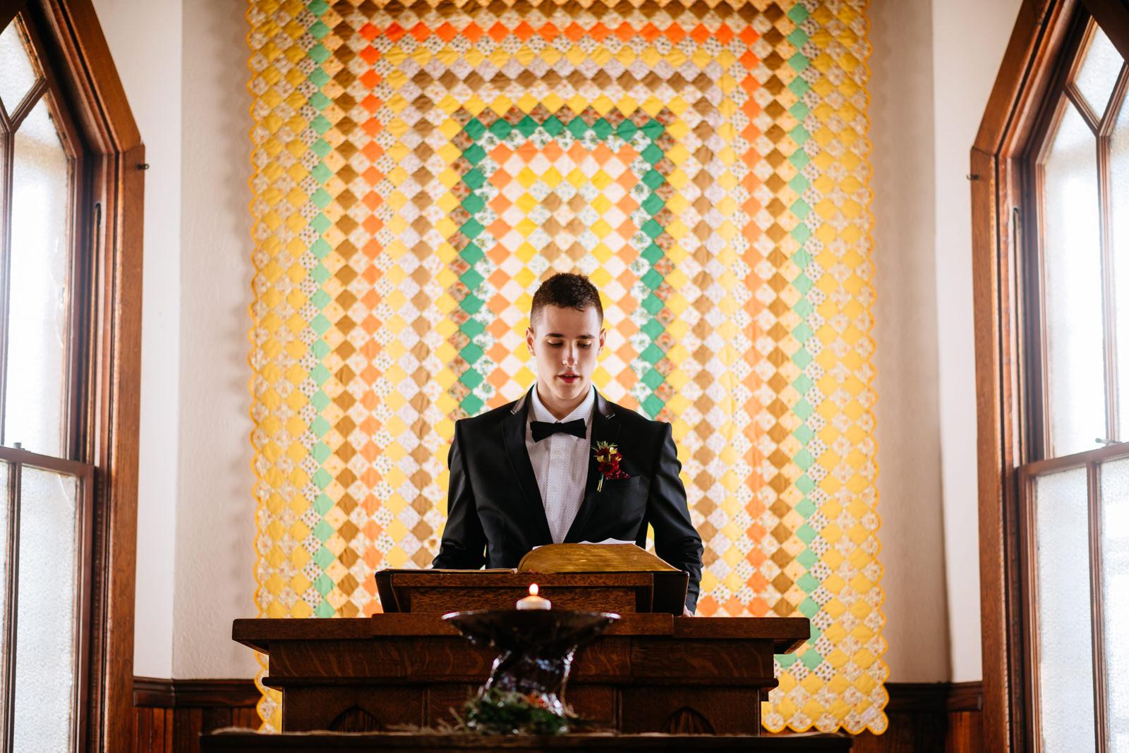 grooms son doing ceremony reading gay wv farm wedding