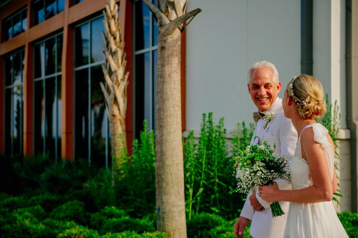 proud father walks bride down aisle