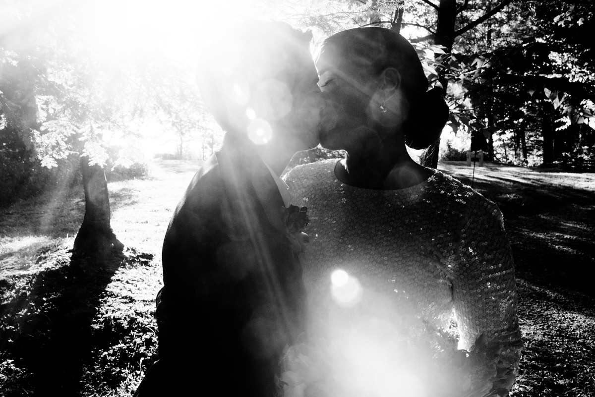 black and white sun flare kissy portrait