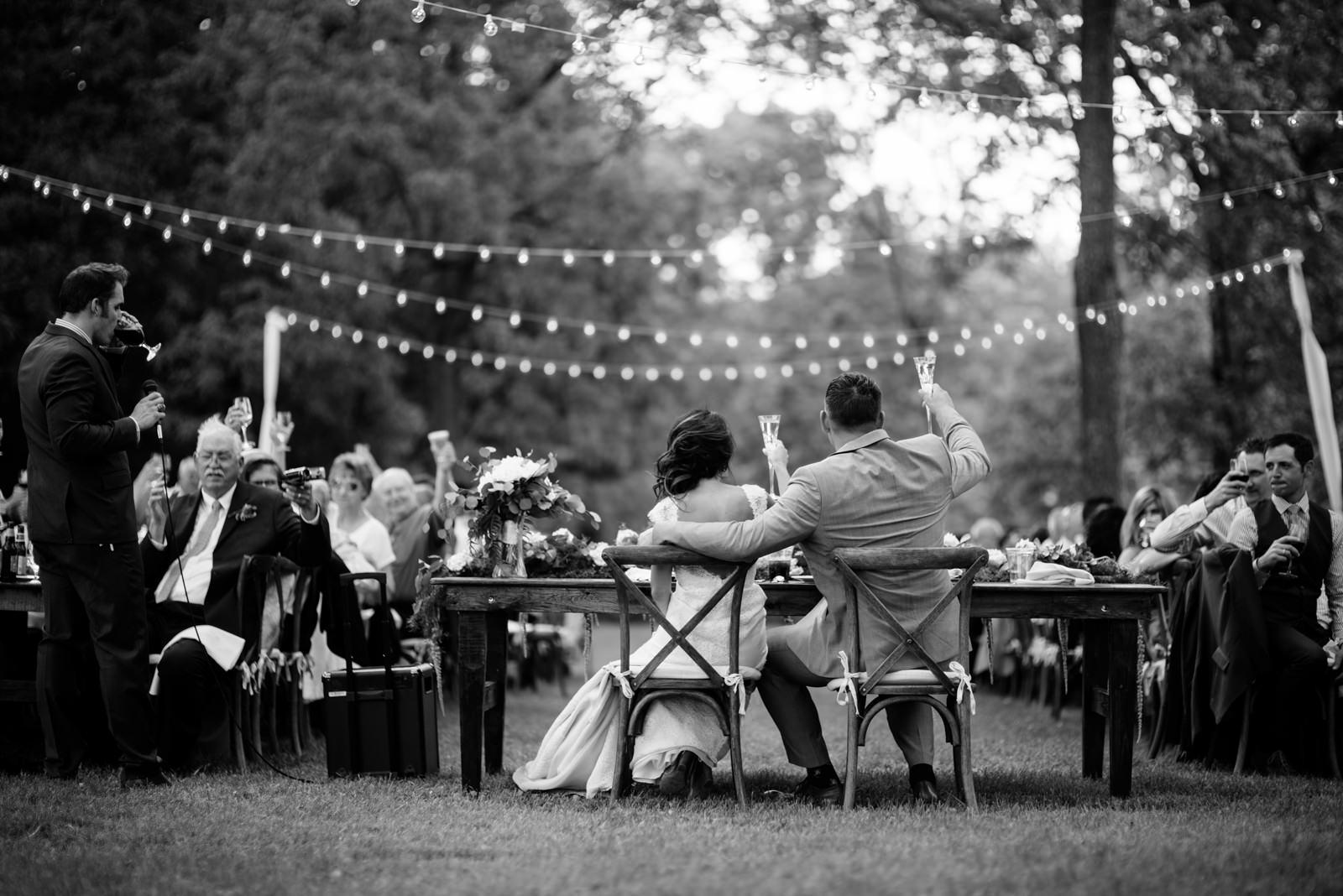 bride groom toasting during outdoor wedding reception gaines estate fayetteville wv wedding