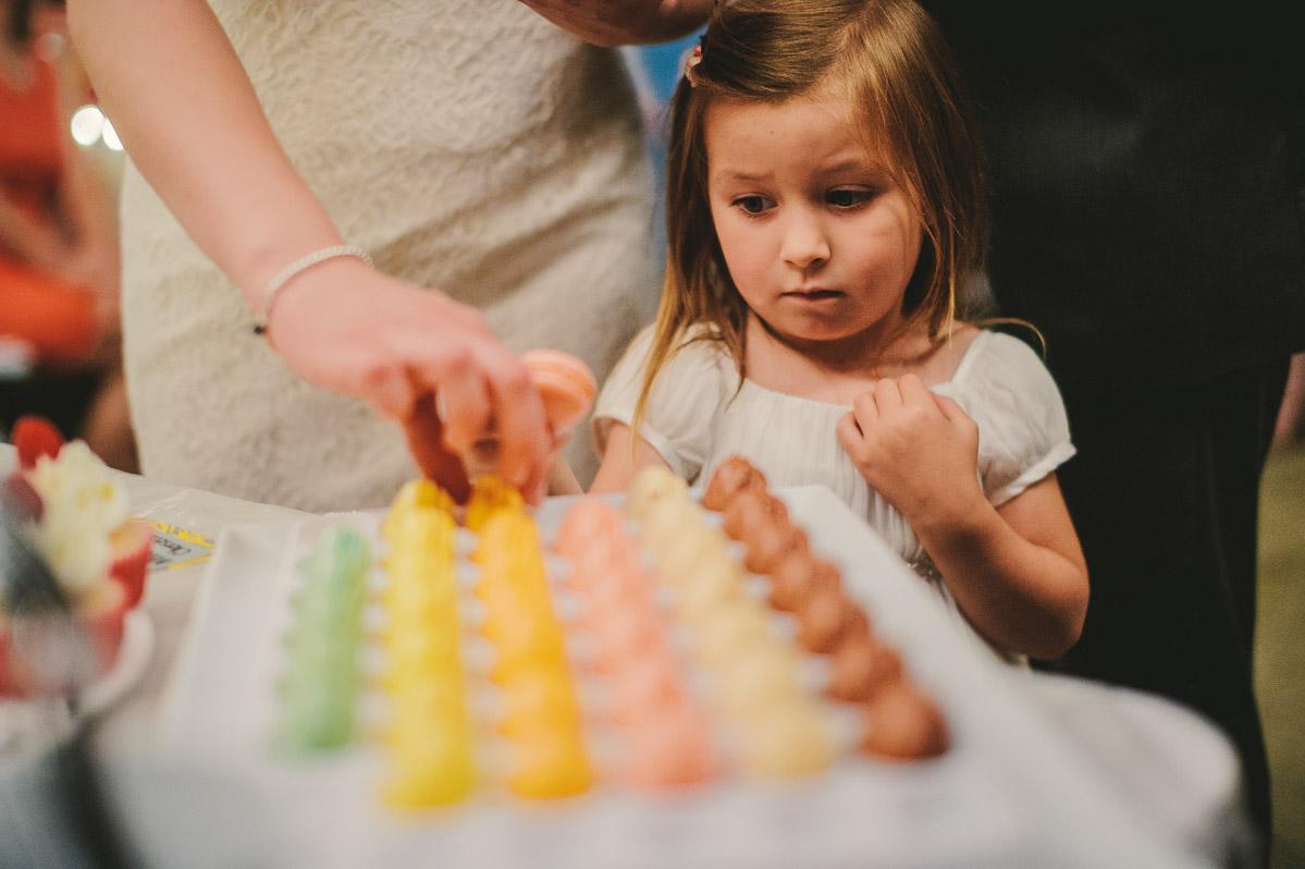 kid eating macarons at wv wedding