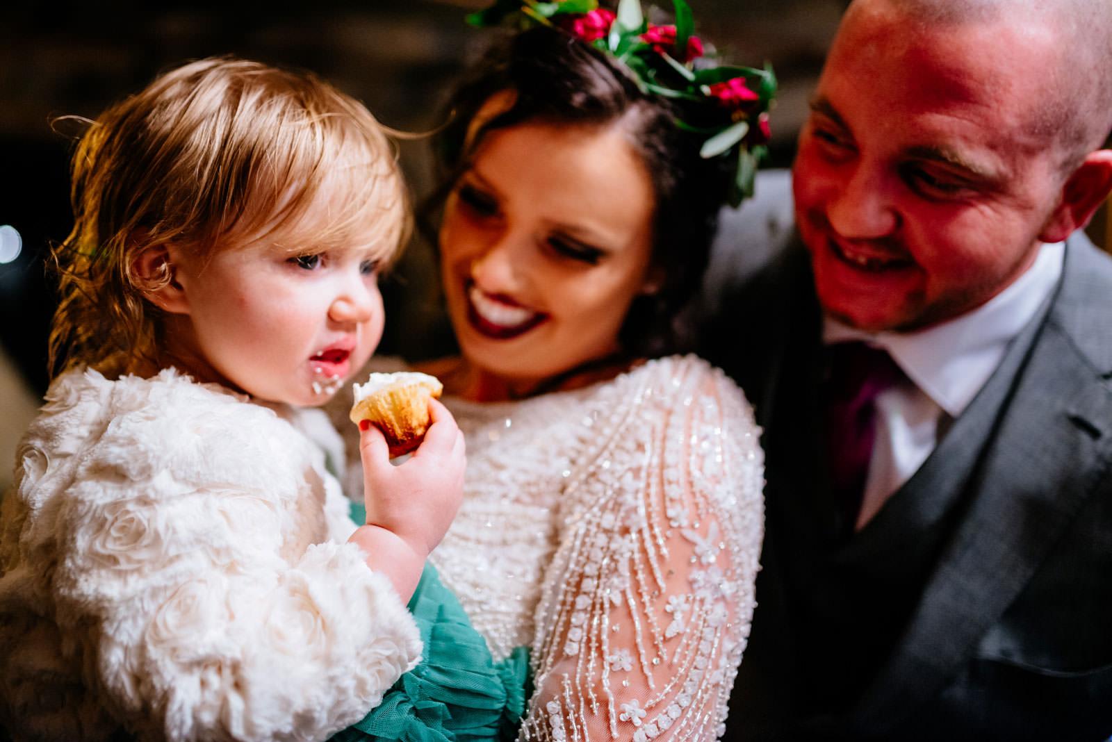 bride groom kid eating cupcake at wedding