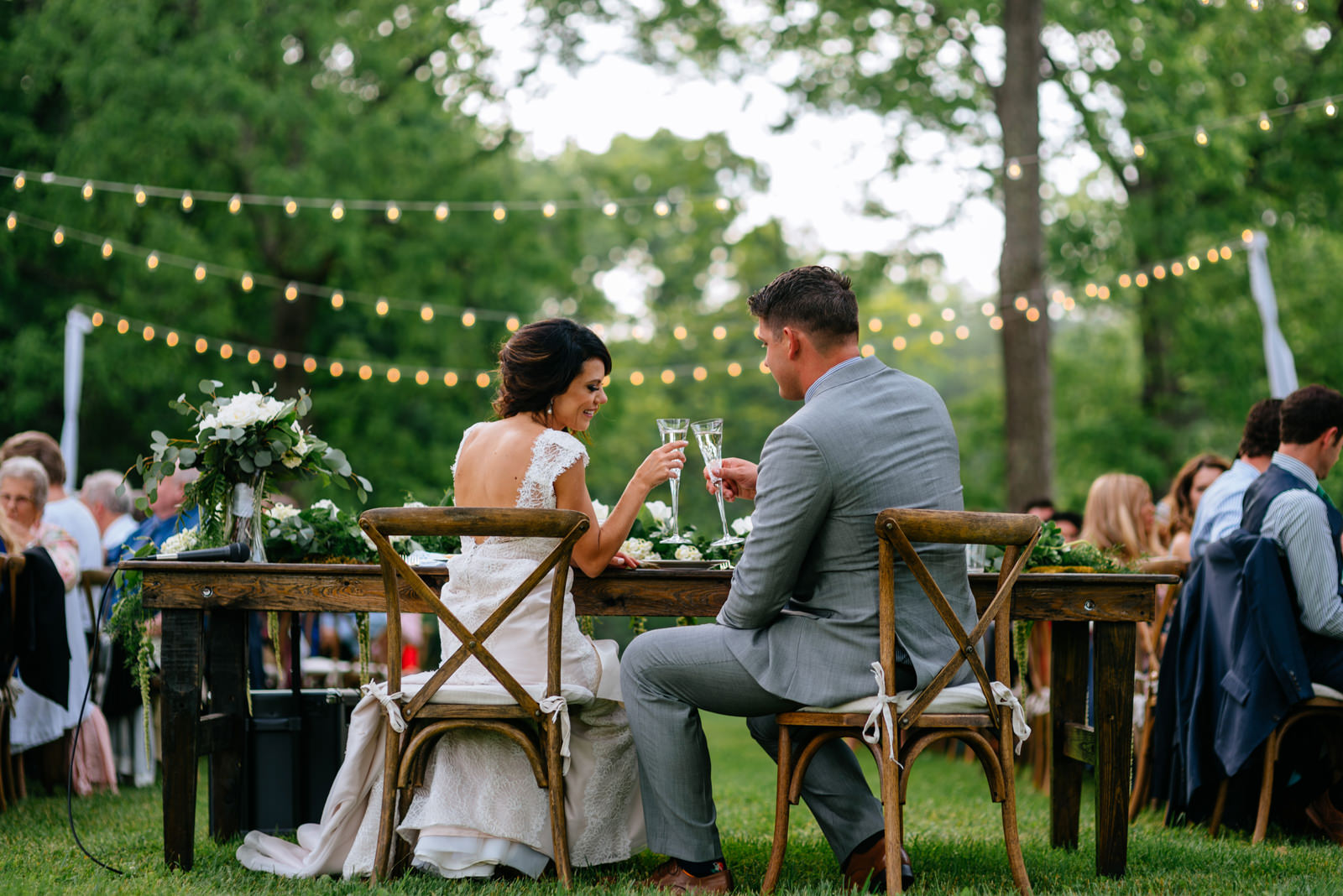 bride groom toasting during outdoor wedding reception